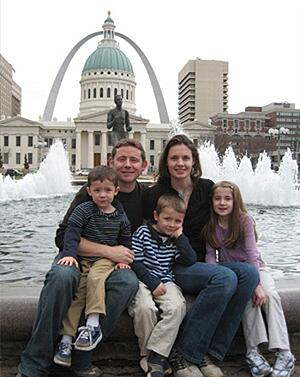 family together in front of arch